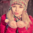 Young Woman Beautiful Winter time wearing knitted hat and gloves and blowing air kiss Lifestyle Expression emotions concept and Christmas holiday trendy colors — Stock Photo #37490371