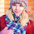 Young Woman Beautiful happy smiling Face Winter time wearing knitted hat and scarf with mittens Lifestyle urban fashion style concept and Christmas holiday — Stock Photo #37490423