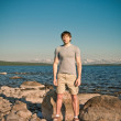 Stock Photo: Handsome Myoung standing Outdoor Lifestyle Traveling concept with lake and mountains on background scandinavinature