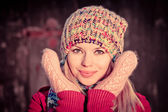 Young Woman Beautiful happy smiling Face Winter time wearing knitted hat and scarf with mittens Lifestyle concept and Christmas holiday trendy colors — Stock Photo