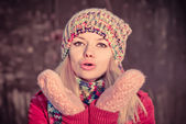 Young Woman Beautiful Winter time wearing knitted hat and gloves and blowing air kiss Lifestyle Expression emotions concept and Christmas holiday trendy colors — Stock Photo