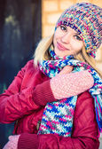 Young Woman Beautiful happy smiling Face Winter time wearing knitted hat and scarf with mittens Lifestyle urban fashion style concept and Christmas holiday — Stock Photo