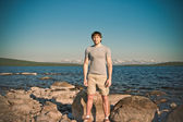 Handsome Man young standing Outdoor Lifestyle Traveling concept with lake and mountains on background scandinavian nature — Stock Photo