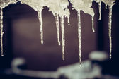 Winter Icicles hanging down from roof — Stock Photo