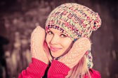 Winter Woman Beautiful happy smiling Face wearing knitted hat and scarf with mittens Lifestyle concept and Christmas holiday trendy colors — Stock Photo