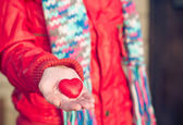 Heart shape love symbol in woman hands Valentines Day romantic greeting people relationship concept winter holiday — ストック写真