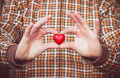 Heart shape love symbol in man hands Valentines Day romantic greeting people relationship concept winter holiday — Stok fotoğraf