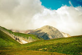 Green Valley with Mountains Landscape on background Summer day — Stock Photo