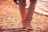 Foot man walking outdoor on beach trendy style melancholy concept — Stock Photo
