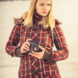 Young Woman with retro photo camera outdoor hipster Lifestyle with winter nature on background — Stock Photo #42618555