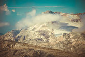 Rocky Mountains with clouds and glacier snow beautiful Landscape Caucasus nature — Stock Photo