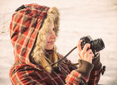 Young Woman with retro photo camera outdoor hipster Lifestyle with winter nature on background — Stock Photo