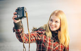 Blonde Woman making self shot on her vintage retro camera happy smiling hipster Lifestyle winter time — Stock Photo