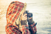 Woman photographer with retro photo camera outdoor Lifestyle concept  winter nature on background — Stock Photo