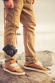 Feet man and vintage retro photo camera outdoor Travel Lifestyle vacations concept — Stock Photo