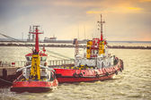 Red Boats in Sea Port transport strait of Kerch in Crimea with sunset sky on background — Stock Photo