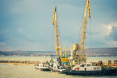 Sea port Crane and ships cargo industrial construction building — Stock Photo