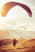 Paragliding extreme Sport with mountains on background Healthy Lifestyle and Freedom concept Summer Vacations — Stock Photo