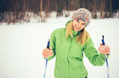 Young Woman with ski happy smiling face winter time snow Skiing Sport and healthy Lifestyle concept — Stock Photo