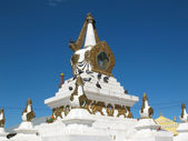Two Mongolian stupas against the blue sky with symbol buddhism — Stock Photo