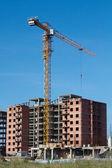 Large tower crane at a construction site a block of flats — Stock Photo