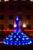 A small fountain illuminated at night in the city of Krasnoyarsk — Stock Photo