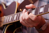 Man's hand, playing the guitar — Foto Stock