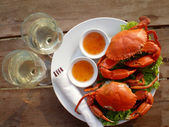 Two crab on a platter and two glasses of white wine — Stock Photo