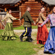 National Ensemble of young guys and beautiful girls dancing the Russian dance — Stock Photo