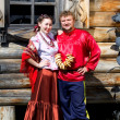 A young boy and a beautiful Russian girl in national costumes — Stockfoto