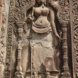 Stock Photo: Low relief on wall of temple at Angkor Wat