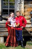 A young boy and a beautiful Russian girl in national costumes — Stock Photo