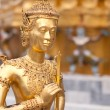 Gold figure in the foreground and in the background the figure is not in focus — Stock Photo