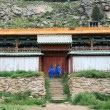 Mountain building of the Buddhist monastery in Mongolia - Stock Photo