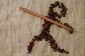 Figure javelin, lined with coffee beans — Stock Photo