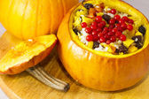 Baked pumpkin stuffed with rice, dried apricots, raisins and banana — Stock Photo