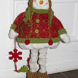 Royalty-Free Stock Photo: The figure of a snowman in a red-green knitted sweater