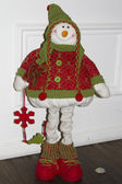 The figure of a snowman in a red-green knitted sweater — Stock Photo