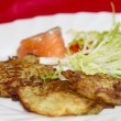 Royalty-Free Stock Photo: Potato pancakes on a plate with a piece of salmon and red caviar