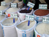 Bags of different varieties of rice in the food market in Cambodia — Stock Photo
