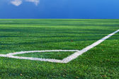 Green artificial turf football and markings near the corner flag — Stock Photo