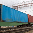 Transportation of containers by rail to freight trains - Stock Photo