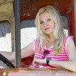 Glamour pretty girl driving a broken truck — Stock Photo