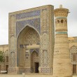 Stock Photo: Building of mosque and minaret in Uzbek city