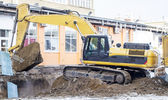 Excavator performs loading of soil into a truck — Foto Stock
