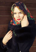Pretty Slavic girl in a black coat and a colored scarf — Stock Photo