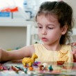 Lovely little girl playing with plasticine — 图库照片