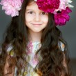 Adorable little girl with wreath from peony flowers in studio — Stock Photo