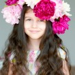 Adorable little girl with wreath from peony flowers in studio — Stock Photo #12311654