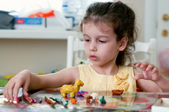Lovely little girl playing with plasticine — Stock Photo